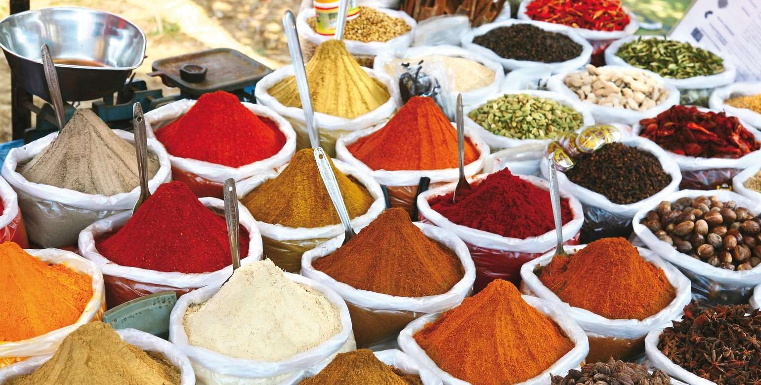 Various of Indian colored powder spices on the Anjuna flea market in India